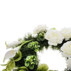 A wreath with flowers of roses, calla lilies, hydrangeas and fir branches.