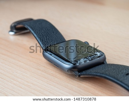 A wrist watch smartwatch with broken glass  stock photo