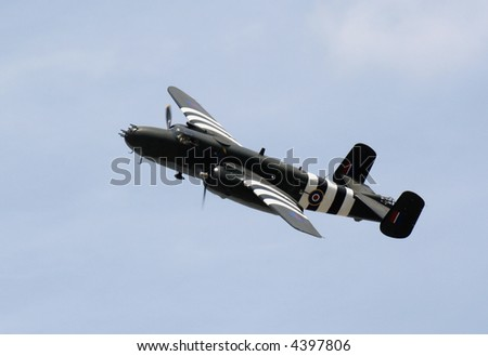 A WWII bomber soaring across the sky.