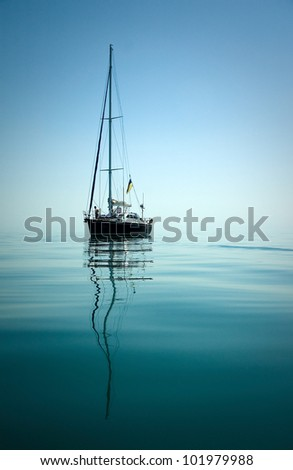 A yacht in peaceful waters