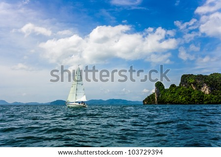 A yacht sailing in the Andaman Sea near the coast of Krabi province of Thailand