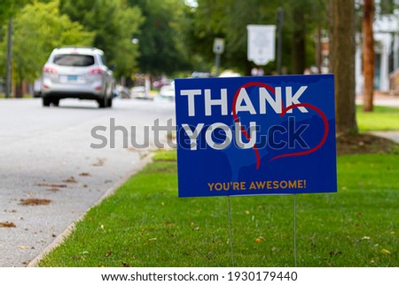 a yard sign by street saying 'Thank you, you are awesome' in white and orange text on blue background. A red heart symbol is embedded. Customizable versatile image with copy space for additional text  ストックフォト ©
