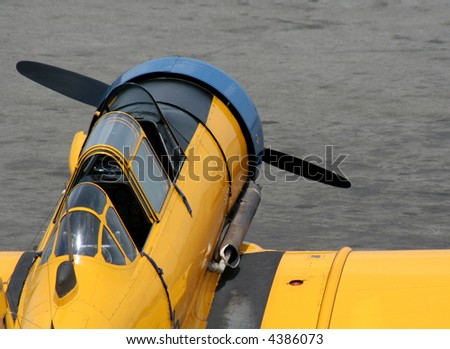 A yellow antique fighter plane.