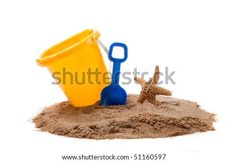 A yellow Bucket and blue shovel on the beach with a starfish