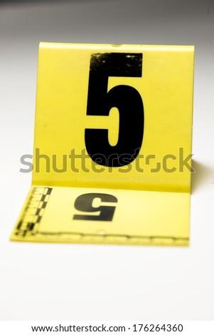 A yellow crime scene marker. - stock photo