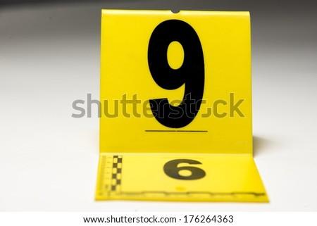 A yellow crime scene marker.
