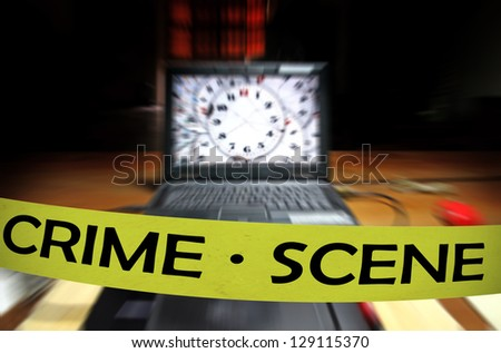 A yellow crime scene tape across a computer laptop on a table in a dimly lit room for the concept of cyber attack by anonymous hackers under investigation.