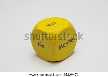 A yellow decision dice on a white background offering a choice between yes, no and maybe
