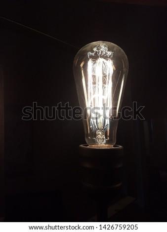 A yellow glowing Edison light #1426759205