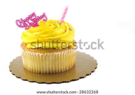 A yellow Happy Birthday cupcake with one unlit pink candle and birthday message, isolated on white with copy space