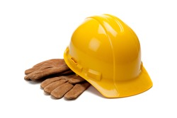 A yellow hard hat and leather work gloves on a white background