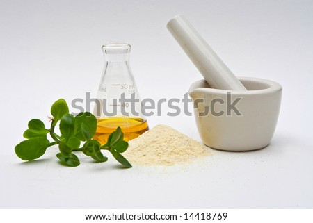 A yellow liquid in a flask with a powder and some leaves in front and a white mortar on a white background