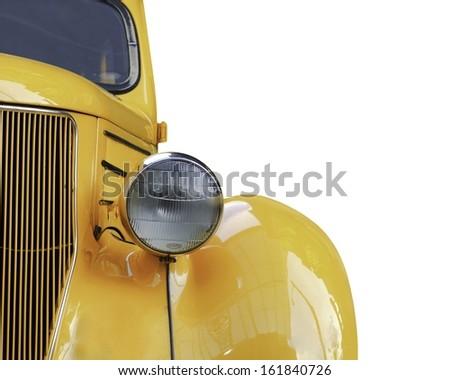 A yellow retro car headlight closeup isolated on white background.