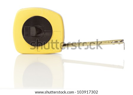 A yellow tape measure on a white background - stock photo