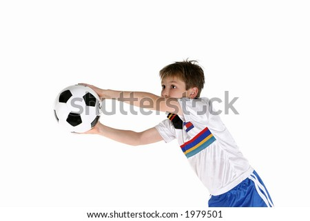 A young active boy playing with a soccer ball.