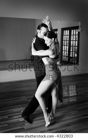 Ples,muzika igra - Page 2 Stock-photo-a-young-adult-couple-dancing-and-practicing-ballroom-dancing-together-in-a-studio-focus-on-woman-4322803