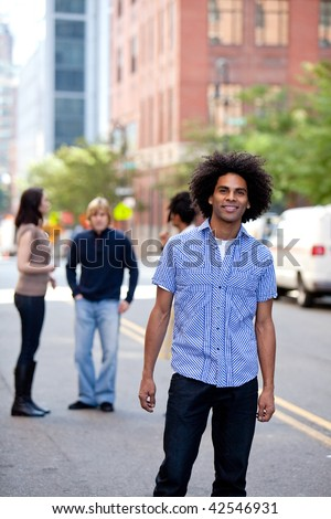 A young adult in a city setting with friends
