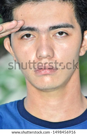 A Young  Adult Male Saluting