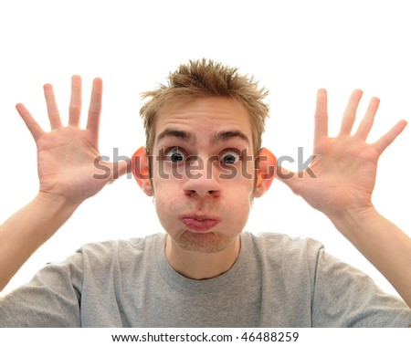 A young adult man makes a silly monkey face over a pure white background