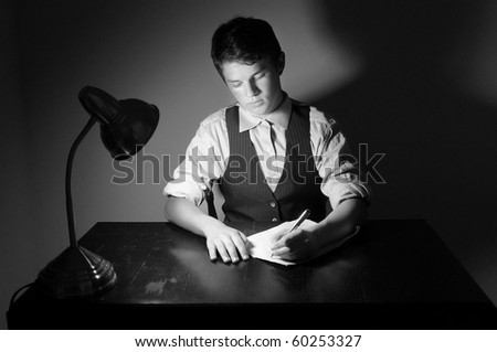 stock photo a young adult man writing a letter on a desk with a lamp 60253327 The two teen idols Justin 17 and Selena 18 are enjoying the Hawaiian sun.