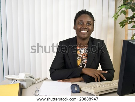 A young African American businesswoman with a big friendly smile.