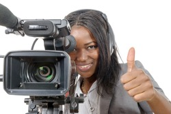a young African American woman with professional video camera and headphone