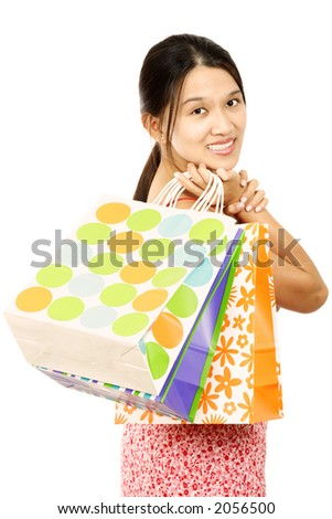 A young and pretty woman carrying shopping bags
