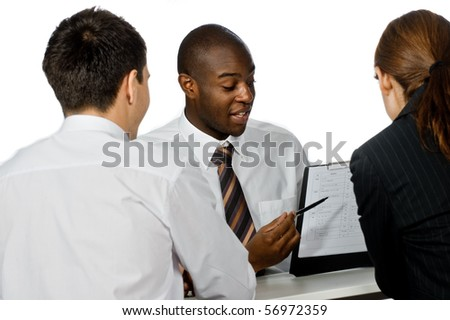 A young and professional businessman having a discussion with two of his colleagues on white background