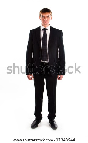 A young and successful business man in a dark business suit colors