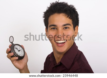 A young Asian American man holds a clock in his hand and smiles