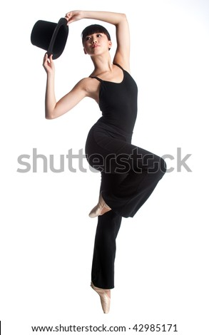 A young asian ballerina dances with a top hat against white background