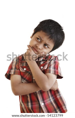 A young asian boy thinking hard. Shot in studio over white background.