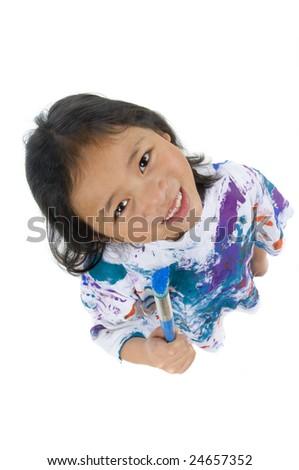 A young asian girl having fun painting