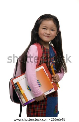 A young asian girl prepares for school with a new backpack