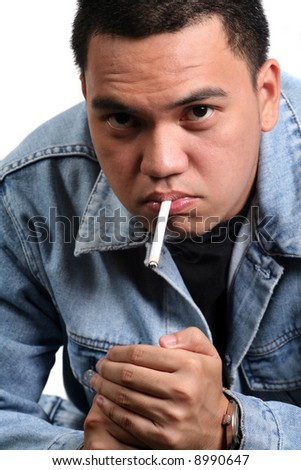 A Young Asian Male Smoking