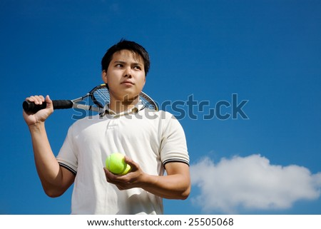 A young asian male tennis player outdoor