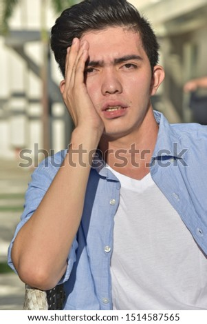 A Young Asian Male Under Stress