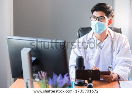 A young Asian medical student studied medicine through an online video conferencing system taught by an Asian adult doctor. Conferencing concepts or online video conferencing systems by doctors