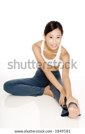A young asian sporty woman stretches her hamstring