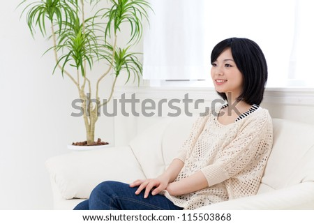 a young asian woman relaxing in the white room