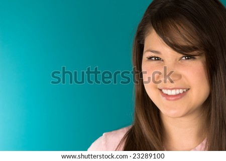 A young Asian woman with a big beautiful smile.