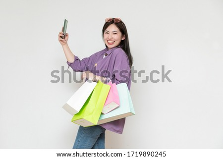 A young asian woman with a shopping bag in her hand Stockfoto ©