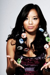 A young asian woman with a stack of poker chips