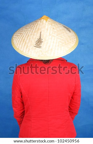 A young asian woman with wide-brimmed rain hat