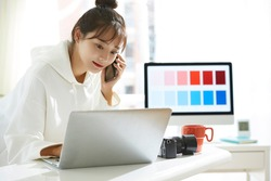 A young Asian woman working in the creative industry