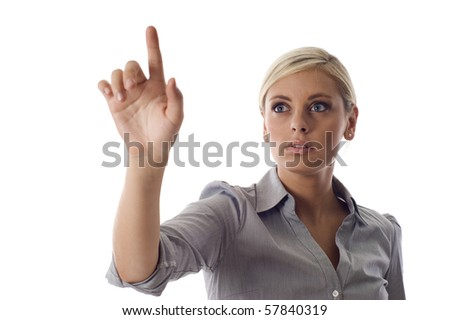 A young attractive business woman pointing at the screen isolated over white background