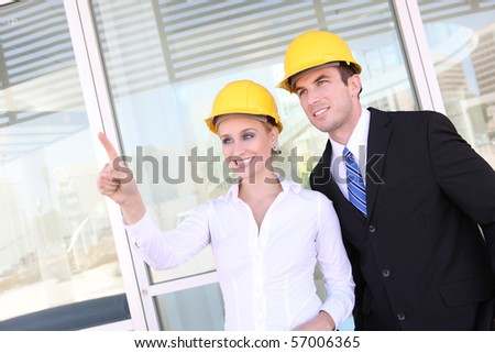 A young attractive man and woman construction team on work site