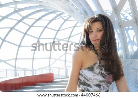 A young Australian woman looking at the view at a new bridge at the Melbourne Docklands