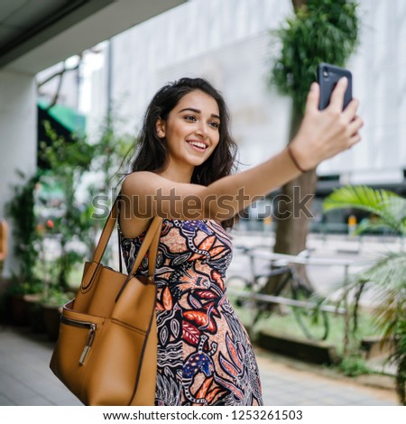 37bfa45c54 A young, beautiful and elegant Punjabi Indian Asian woman takes a selfie of  herself with