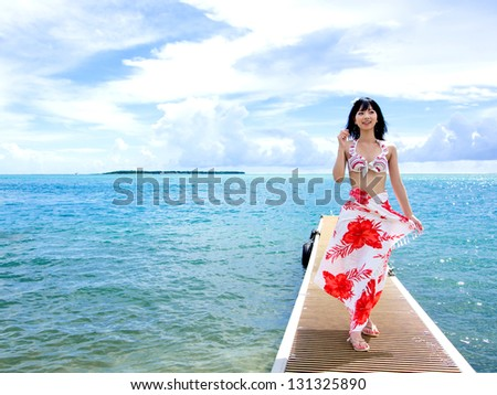 a young beautiful asian woman on the jetty